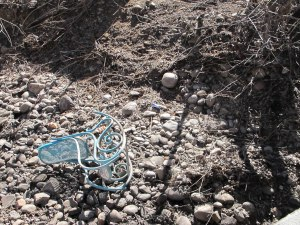 A rocking chair in a dry creek bed in Colorado.