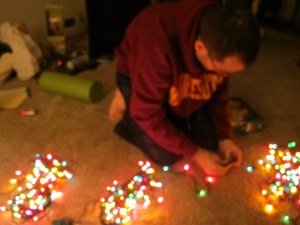 My love preparing the Christmas tree lights.